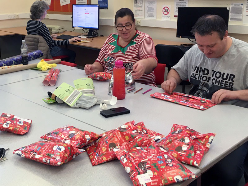 volunteers wrapping presents thurnscoe library